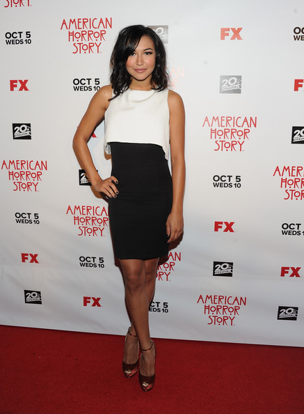 Naya Rivera added a pop of color to her black and white ensemble with pumpkin-colored satin peep-toe pumps, complete with chic ankle straps.