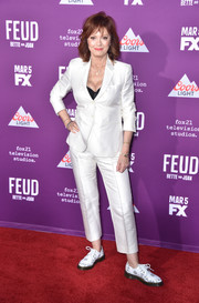 Susan Sarandon attended the premiere of 'Feud: Bette and Joan' wearing a sleek white pantsuit by Max Mara.