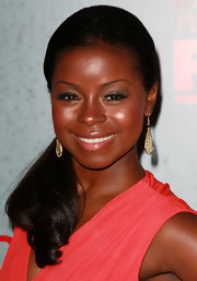 Erica Tazel glowed at the season three premiere of 'Justified.' She wore pops of vibrant coral-pink cream blush on the apples of her cheeks and a pretty sheer pink gloss with loads of shine.