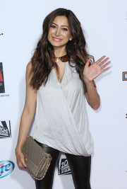 A quilted nude leather bag added a touch of elegance to Noureen DeWulf's edgy look during the 'Sons of Anarchy' season 6 premiere.