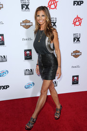 Charisma Carpenter looked edgy-sexy in a black leather mini skirt and an embellished top during the premiere of 'Sons of Anarchy' season 6.