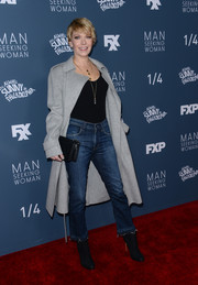 Underneath her coat, Mary Elizabeth Ellis kept it casual in cropped jeans and a tight top.