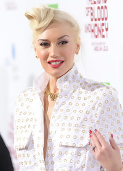 Gwen Stefani showed off her metallic red polish at the premiere of 'In the Land of Blood and Honey.'
