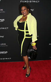 Loretta Devine grabbed some major attention while on the carpet when she wore this black and neon bandage dress.