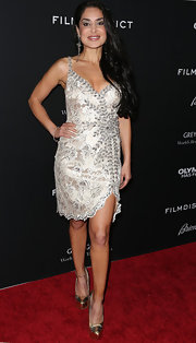 Saye Yabandeh showed off her feminine curves with this silver cocktail dress with crystal embellishments.