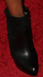 Tasha Smith chose cool suede and leather booties for a red carpet look with a rock 'n roll edge.