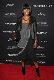 Tasha Smith paired this cool print dress with a textured leather jacket for an edgy, rocker look.