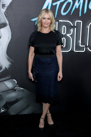 Chelsea Handler dressed up her tee with a navy lace pencil skirt.