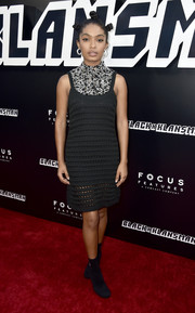 Yara Shahidi looked edgy-chic in a black Prada knit dress with a heavily beaded neckline at the premiere of 'BlacKkKlansman.'
