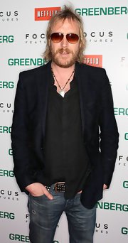 Rhys Ifans tamed the edginess of his jean and shirt ensemble with a black blazer.