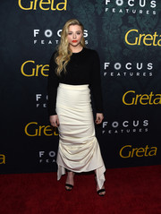 Chloe Grace Moretz attended the premiere of 'Greta' wearing a simple black cardigan.