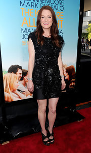 Sporting an embellished cocktail dress, Julianne rocked a pair of studded, cutout, satin booties.