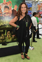 Tia Carrere sported a boho vibe with this fringed black one-shoulder top at the premiere of 'ParaNorman.'