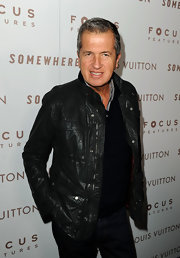 Mario Testino added a luxe touch to his look with a cool leather jacket.