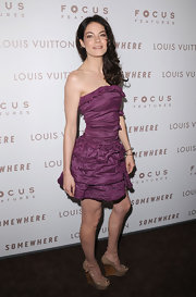 Michelle Monaghan paired a purple ruffled Lanvin dress with nude patent wedges embellished with sweet bows.