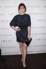 Ellie Kemper wore nude platform pumps with a flattering navy blue mini dress.