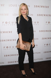 "Mena Suvari stayed right on-trend carrying an oversize leopard print clutch by Kelly Locke. The calf-hair ""Francke"" clutch added exotic appeal to Mena's monochromatic look."