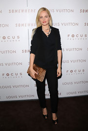 Mena Suvari donned flirty black peep toes with her monochromatic look. The heels feature gemstone adorned toes.