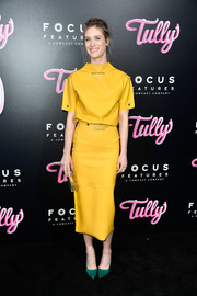Mackenzie Davis brought a bright pop to the premiere of 'Tully' with this yellow funnel-neck top by Calvin Klein.