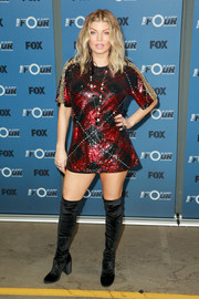 Fergie teamed her dress with black velvet over-the-knee boots.