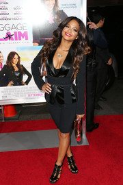Christina Milian looked funky at the 'Baggage Claim' premiere in a fitted black jacket and bike shorts.