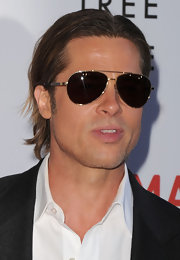 Brad Pitt looked effortlessly cool at the premiere of 'Tree of Life' in David Yurman's Exotics Sunglasses in gold tortoise.