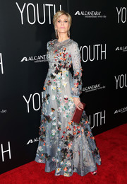 Jane Fonda's red satin clutch and slate-blue gown made a lovely color combo.