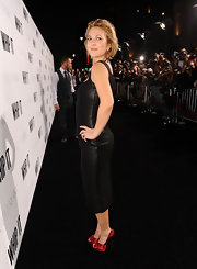 "Drew made a sultry appearance at the ""Whip It"" premiere in a hip-huggin dress. Her red satin peep-toes were a nice way to break up her all black ensemble."