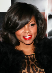 Taraji vamped up her layered bob with a swipe of classic red lipstick. This touch instantly gave her a retro-glam look.