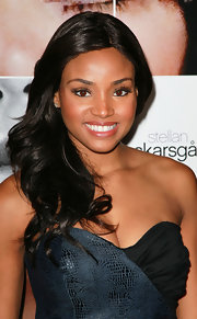 Meagan Tandy paired her flowing curls with bold lashes.