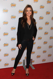 A newly brunette Denise Richards looked polished and chic in a pair of black peep toe pumps. She paired the versatile heels with dark skinny jeans and a silk top.