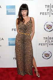 Paz de la Huerta teamed her leopard print evening dress with bronze metallic T-strap sandals.