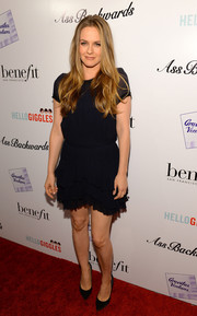 Alicia Silverstone sported a youthful vibe in a navy mini dress with a tiered skirt during the 'Ass Backwards' premiere.