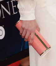 Lena Headey paired her all-white frock with this salmon pink cylindrical clutch.