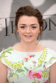 Maisie Williams pulled back her brunette tresses into a messy updo for a cool and totally age-appropriate style.
