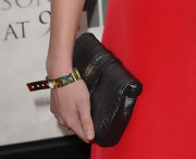 Alison Pill added some metallic sheen to her colored-blocked look with this black clutch.