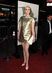 Gwendoline Christie's gold dress with its cool floral cutouts had a cool rocker-vibe.