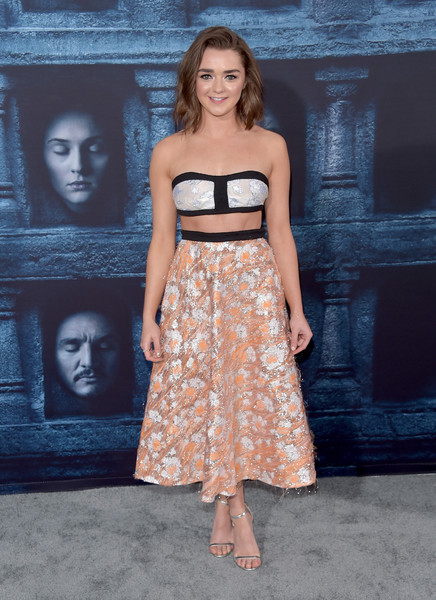 Maisie Williams completed her outfit with silver ankle-strap sandals by Jimmy Choo.