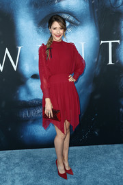 Amanda Crew chose a long-sleeve red cocktail dress with a handkerchief hem and ruffle detailing for the premiere of 'Game of Thrones' season 7.
