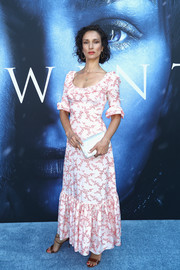 Indira Varma paired her dress with a metallic silver clutch.