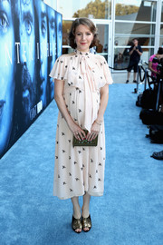 A cute book clutch finished off Gemma Whelan's ensemble.