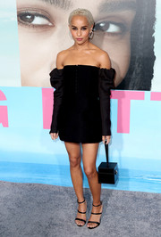 Zoe Kravitz amped up the modern feel with a leather box wristlet by Moynat.