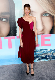 Laura Dern looked avant-garde wearing this Vivienne Westwood one-shoulder dress, in maroon with a fuchsia underlay, at the premiere of 'Big Little Lies.'