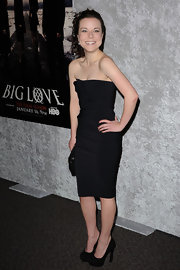 Tina looked sophisticated in black suede platforms. The heels were an ideal choice for her fitted strapless dress.