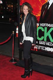 Amy was on trend for fall in a leather jacket and knee-high boots.