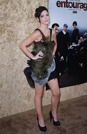 The actress completed her feathered frock with patent platform pumps.