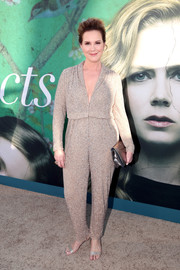 Elizabeth Perkins complemented her jumpsuit with a pair of glitter sandals.
