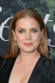 Amy Adams accessorized with a pair of gemstone drop earrings by Cartier for a more glamorous finish.