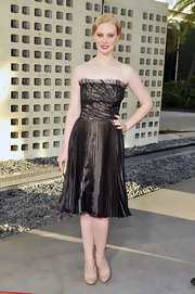 Deborah Ann Woll kept the focus on her glitzy lamé dress with a pair of classic nude patent pumps.