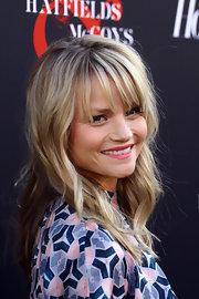 Lindsay Pulsipher arrived at the premiere of 'Hatfields & McCoys' wearing her layered locks in beachy waves with lash-grazing bangs.